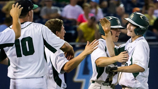 St. Mark's  Christopher Ludman (No. 20) is mobbed by his teammates after scoring the team's eventual winning run in the bottom of the sixth inning of the DIAA Baseball State Championship game at Frawley Stadium in Wilmington on Tuesday evening. St. Mark's defeated Caravel 5-4.