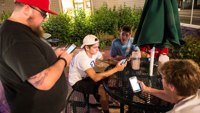 "In this file photo, people look for Pokemon at the fountain in Annville as people across Lebanon County played ""Pokemon Go"" on Tuesday, July 12, 2016."