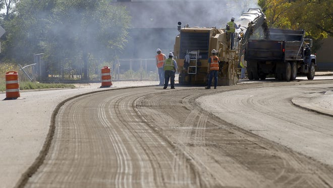 Riverside Ave. is milled to begin the repaving project Oct. 3, 2011. This project was paid for by the Keep Fort Collins Great tax, which has come under new scrutiny as it relates to Colorado's Taxpayer's Bill of Rights.