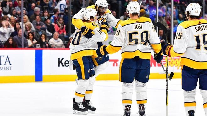 Mar 16, 2018; Denver, CO, USA; Nashville Predators center Colton Sissons (10) celebrates his goal with defenseman P.K. Subban (76) and defenseman Roman Josi (59) in the first period against the Colorado Avalanche at the Pepsi Center. Mandatory Credit: Ron Chenoy-USA TODAY Sports