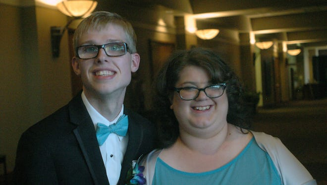 Cassie White and her prom date, Tommy Goike, take a break from the big event to share a smile.