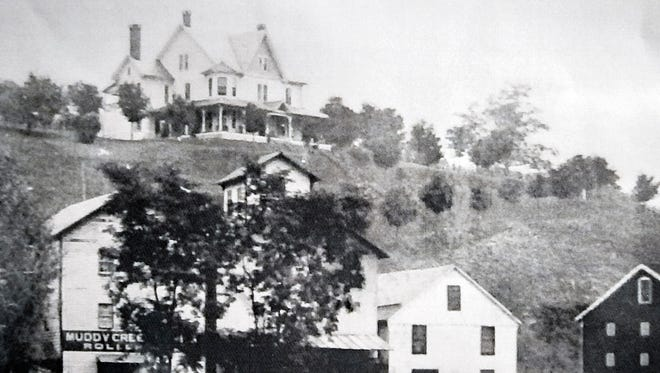 Now obscured by trees, a view of the the historic A.M. Grove house at top of photo.