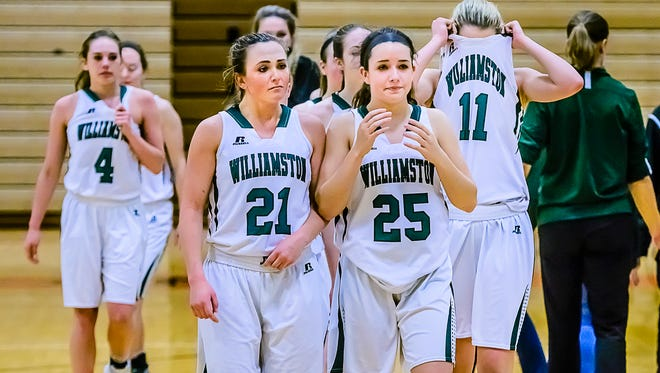 The Williamston girls basketball team walks off the court after their 41-39 Class B state quarterfinal loss to Ypsilanti Arbor Prep Tuesday March 14, 2017 at Brighton High School in Brighton.  KEVIN W. FOWLER PHOTO