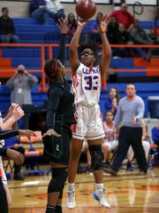 Central's Latavia Dosson takes a shot while guarded