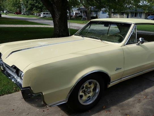A saffron yellow 1967 Cutlass Supreme owned by Fred