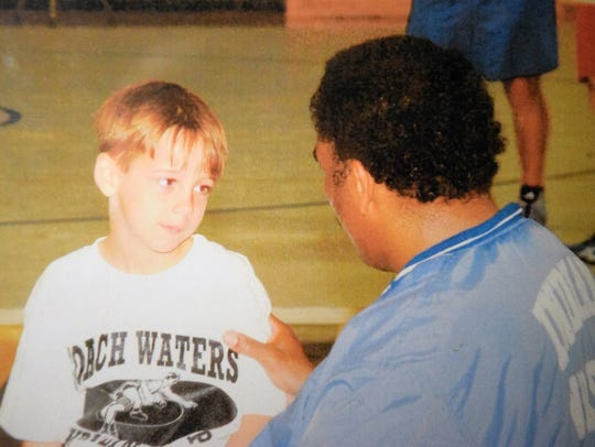 Five-year-old Matthew Farrar, left, talks with then-Fort