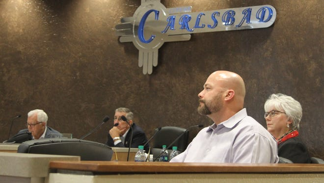 New Mexico Department of Transportation designee Tim Parker listens to the technical work group presentation at the Carlsbad Brine Well Remediation Advisory Authority meeting Tuesday, Nov. 28, 2017.