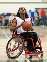 Norris Foster on the court playing wheelchair basketball.