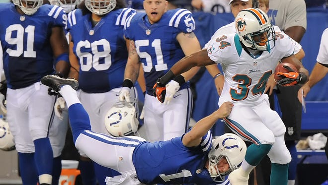 Colts punter Pat McAfee was the last and only person to stop the return on Marcus Thigpen on a punt late in the fourth quarter. The Colts won 23-20 over the Miami Dolphins at Lucas Oil Stadium on November 4, 2012. (Matt Detrich / The Star)