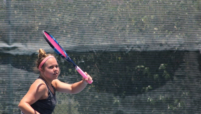 Kaitlyn Strain, who will be a freshman at Abilene High, returns a shot during a practice session Wednesday at the Rose Park Tennis Center. She is entered in The Texas Slam, a junior tournament that begins play Saturday on courts across Abilene. Strain plays her first 16s singles match Sunday.