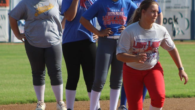 Durant High School Lady Lion softball players work on base-running drills during the first week of official practices.