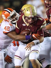 Clemson defensive lineman Christian Wilkins (42) sacks Boston College quarterback Patrick Towles (8) during their game at Boston College on Oct. 7.