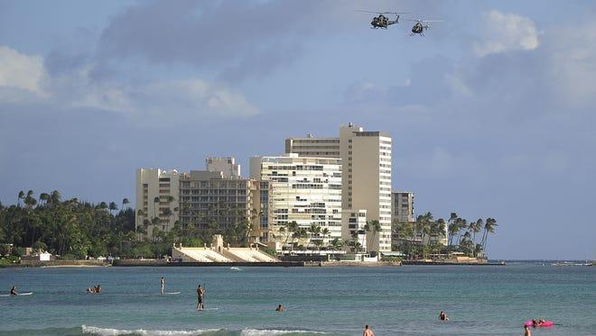 Helicopters patrol over Waikiki beach Nov. 10, 2011.