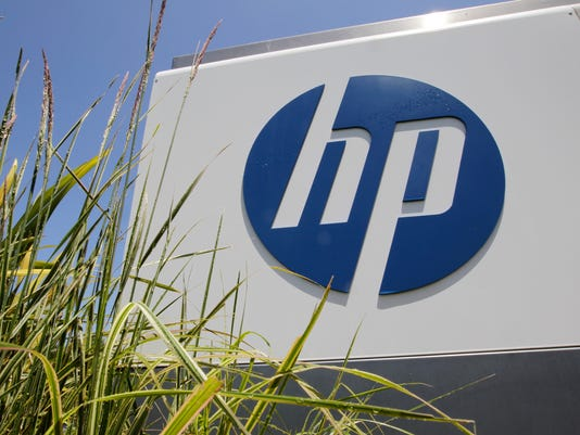 635782471434133137-HP-sign-AP-Hewlett-Packard-Job-Cuts-