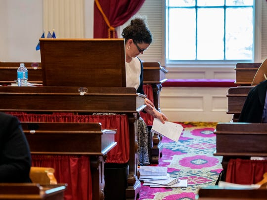 Rep. Laura Sibilia, I-West Dover, empties her desk at the Statehouse in Montpelier on Friday. The Legislature is expected to adjourn today.