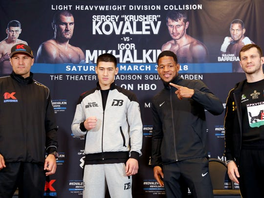 Boxers, from left, Sergey Kovalev, Dimtry Bivol, Sullivan Barrera, and Igor Mikhalkin pose for a picture during a news conference in New York, Wednesday, Feb. 28, 2018. Kovalev and Mikhalkin will headline the fights slated for Saturday at The Theater Madison Square Garden in New York. (AP Photo/Seth Wenig)