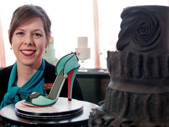 Stephanie Baumann, owner of Let Them Eat Cake, poses