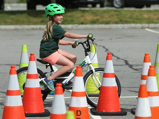 10-year-old Madison Ridner of Denville during the 3rd Annual Denville Kiwanis Bicycle Rodeo with the Denville Police Department with helmet and bike inspections, minor adjustments and teaching youngsters about bike safety.  June 8, 2017, Denville, NJ.