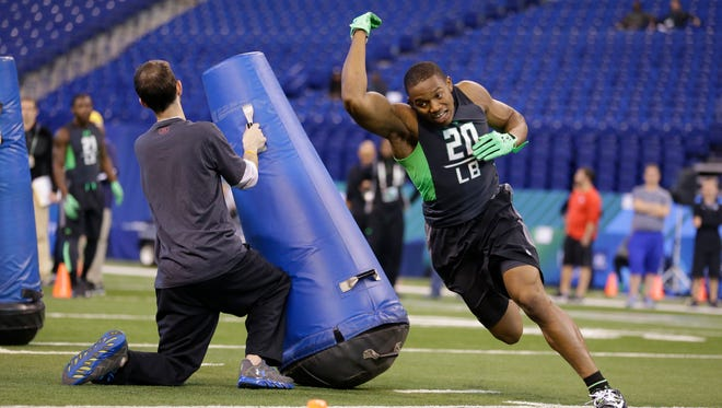 Ohio State linebacker Darron Lee runs a drill at the NFL scouting combine in Indianapolis on Feb. 28, 2016.