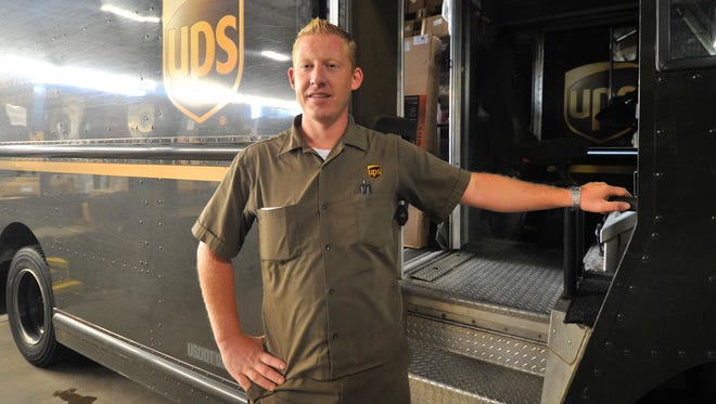 UPS route driver John Johnson poses for a photo at UPS Customer Center in Wausau on Wednesday morning.