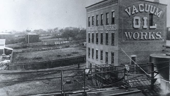 Photo from 1874 of Vacuum Oil's first refinery, located at the corner of what now are Exchange and Flint Streets.