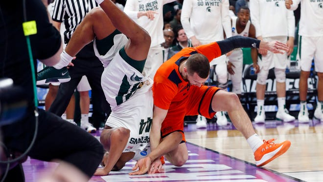 Michigan State forward Nick Ward lands on his head after colliding with Bucknell guard Kimbal Mackenzie during the second half.