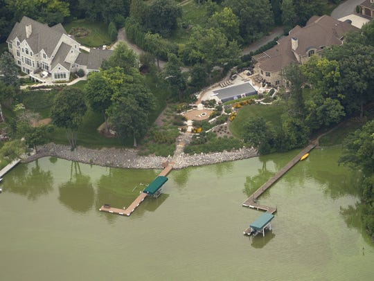 Algae blooms are shown in August on the Fox River south