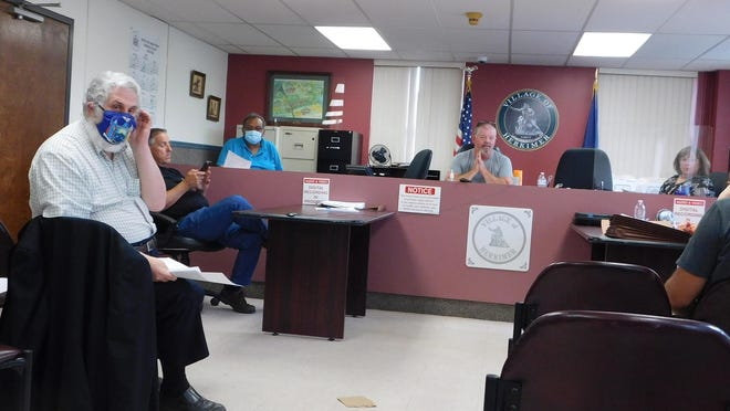 Herkimer Village Trustee Ronald Kopelman, left, turns around to ask a question during Monday's meeting of the Herkimer village board. Also shown are, from left, Village Attorney Nicholas Macri, Trustee Max Dhaniram, Mayor Mark Netti and Trustee Maria Fiorentino. Deputy Mayor Mark Ainsworth was also present.