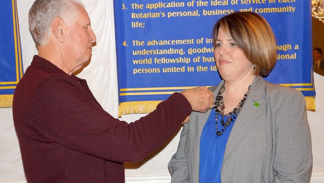 Bridget M. Sharer receives her Rotary Club member pin from her sponsor, Ed Morvay of the Rotary Club of Vineland