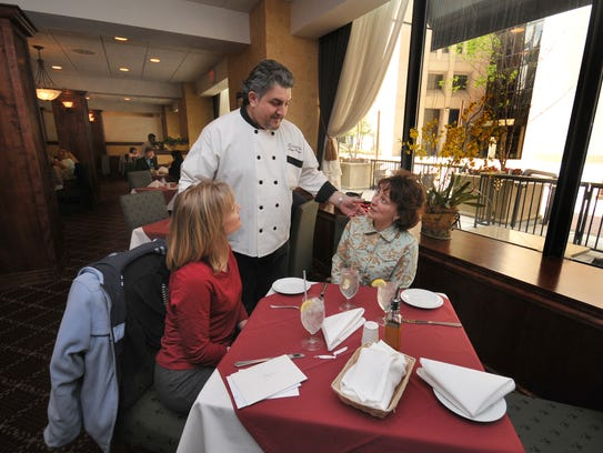 In this file photo, Chef/owner Sergio Pellegrino chats