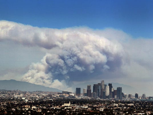Los angeles area wildfires burning closer to each other