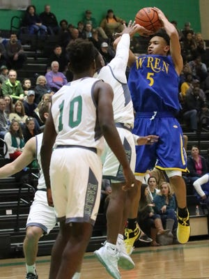 Wren's Trey McGowens (5) shoots over Easley's Riley Gentry (5) in the second quarter of their game at Easley High School in Easley on Friday night, December 16, 2016.