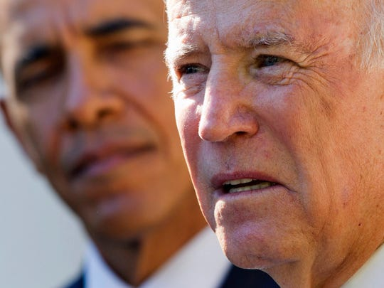 A file photo of then-President Barack Obama listening as Vice President Joe Biden speaks in the Rose Garden of the White House.