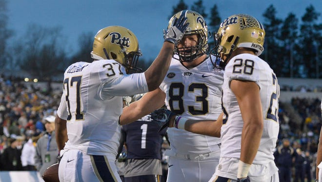 Pittsburgh Panthers running back Qadree Ollison (37) celebrates with teammates after scoring a touchdown during the third quarter against the Navy Midshipmen at Navy-Marine Corps. Stadium.