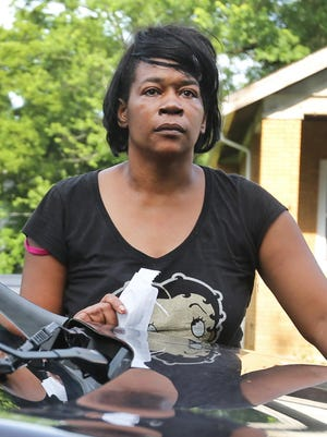 "Khanita Maston, mother of Trepierre Hummons, prepares to meet with the coroner's office. On Friday morning, June 19, her son lured police to Madisonville and tried to commit ""suicide by cop."" He ultimately killed District 2 Police Officer Sonny Kim, before police shot and killed him. His mother witnessed the entire scene."