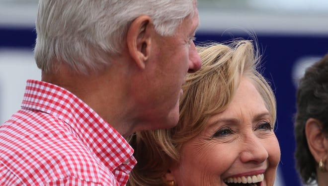 Hillary and Bill Clinton flip steaks with Tom Harkin and crew in Indianola at the Harkin Steak Fry. Sunday, Sept. 14, 2014.