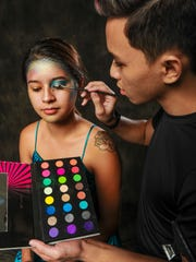 Freelance makeup artist Clay Josh Aflleje uses complimenting makeup to complete Pacific Daily New reporter Chloe Babauta's makeover into a Halloween mermaid on Thursday, Oct. 13.