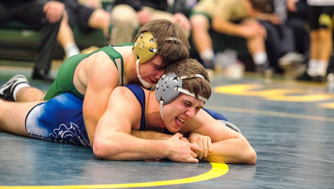 Iowa City West's Donovan Doyle wrestles Pleasant Valley's Chance Cary at 195 lbs at the 23rd annual IC West Lepic Duals at West High on Saturday, January 10, 2015.