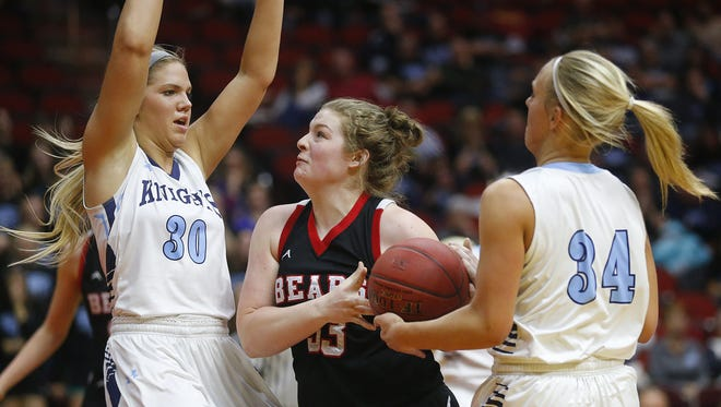 West Branch's Jenae Murry fights for the ball against Unity Christian's  Anna Kiel, left, and Deidra Noteboom during the state basketball tournament quarterfinals Monday.
