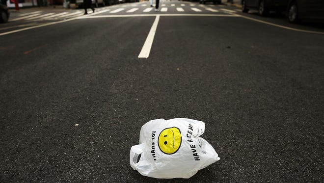A plastic bag sits in a Manhattan street in May 2016. New York City agreed to impose a fee on single-use plastic bags. Some Michigan legislators aim to stop local governments in the state from enacting similar ordinances with a ban prohibiting regulation of plastic bags.
