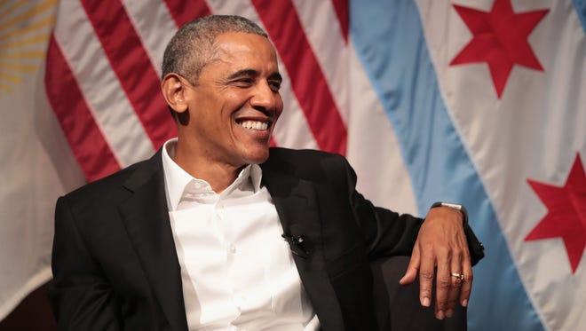 Former president Barack Obama visits with youth leaders at the University of Chicago to help promote community organizing on April 24 in Chicago. The visit marked Obama's first formal public appearance since leaving office.