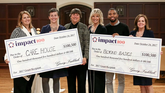 From left, Tricia Schuster and  Blythe Spitsbergen of Care House, Ginny Fischbach and Mary Pat Rosen of Impact100 Oakland County, and Javier Reed and Pamela Good of Beyond Basics are at the annual meeting for Impact100 Oakland County on October 24, 2017. Five nonprofit finalists presented that same evening and the members voted Care House and Beyond Basics as the top two.