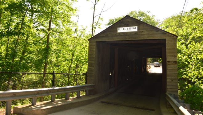 Bull's Bridge is a historic covered bridge in Kent, Connecticut, that is part of a scenic river hike.