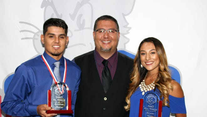 Cristian Metz and Bryssa Nieto received the Mr. and miss Wildcat Award from DHS Athletic/Activities Director Bernie Chavez as the 2016-17 best all-around athletes at Deming High School.