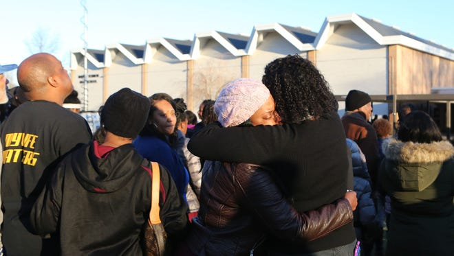 Nadine McKenzie is consoled after a service for her daughter, Shamoya McKenzie, at Mount Vernon High School Jan. 1, 2017. Basketball standout Shamoya McKenzie, 13, was killed by a stray bullet on New Year's Eve when traveling in the passenger seat of her mother's car. The community, her teammates, friends and family gathered to remember at the high school.