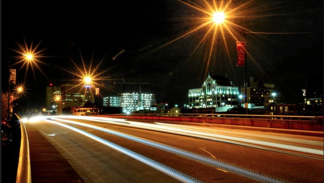 Cars drive along the Academy Street bridge with a view Greenville's skyline in the background on Tuesday, Nov. 27, 2012.