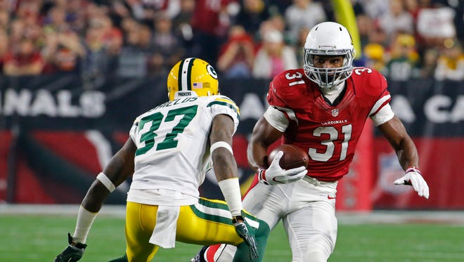 Cardinals running back David Johnson (31) runs upfield into the tackle of Packers Sam Shields (37) in the first quarter during 2016 NFC Divisional Playoff Game at the University of Phoenix Stadium in Glendale, Az., on Saturday, January 16, 2016.