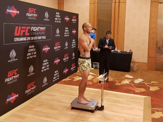 "Frank ""The Crank"" Camacho smiles as he officially makes weight for his fight tomorrow night in Singapore. Camacho weighed 169 the night before, a pound clear of his max weight, but he said he was still nervous about it."