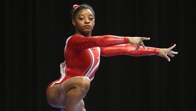 Simone Biles balances on the balance beam during the P&G Championships Senior Women's rounds, at Bankers Life Fieldhouse, Saturday, August 15, 2015.