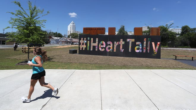 A new sculpture is set to be unveiled Thursday at Capital Cascades Trail, a nod to the city featuring the text 'TLH'. The art work is currently being masked by the art work of Oakridge Elementary students who have listed the various reasons they love Tallahassee in a painting that will be removed as the structure officially goes live.